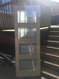 Solid oak 4 panel shaker door with obscure glass panels.