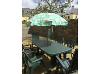 Green Outdoor setting including umbrella