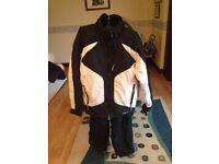 Black and white ski jacket and matching salopettes -