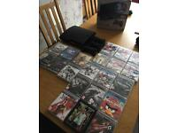 PS3 slim 320gb boxed with 21 games and 3 controllers