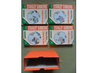STANLEY GIBBONS STAMP ALBUMS - COMPLETE BOX SET OF 4 LARGE ALBUMS. VGC.