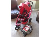 Phil and Teds Sport buggy in red with rain cover