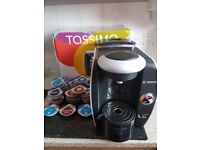 Tassimo coffee machine +21 pods (few months old)