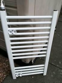 Small white electric towel radiator