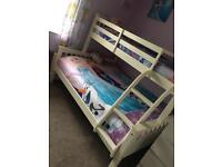 White wooden triple bunk bed