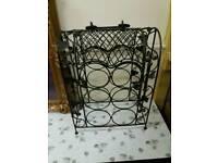Ornate metal wine rack