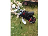 Set of kids golf clubs and stand bag