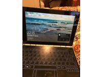 Lenovo Yogabook with Windows 10 with halo keyboard and stylus and Real ink pen