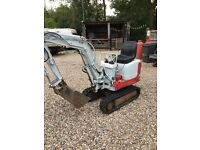 Takeuchi digger with expanding tracks
