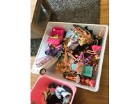 Selection of Barbie/Bratz dolls and cars