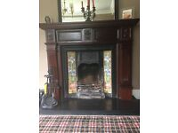 Ornate mahogany fire surround complete with tiled cast iron inset and grate.