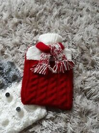 Luxury hand knitted hot water bottle cover complete with standard size bottle.