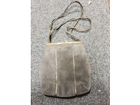 womens grey sweade hand bag made by a designer in spain used