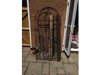 2x Black painted steel gates.