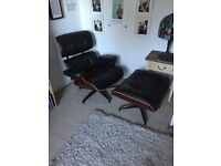 Reproduction Eames chair and foot stool for sale.
