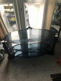 Black glass oval tv stand
