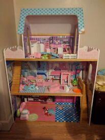 Dolls house with lots of furniture and dolls