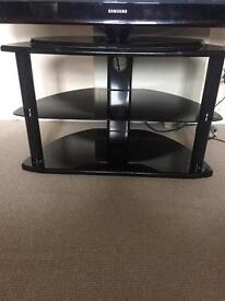 Black gloss tv stand middle shelf is glass