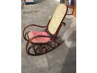 Bentwood style rocking chair . Mahogany frame . Unusual style. Must be seen. Free local delivery.