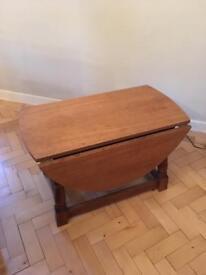 Solid oak coffee table- drop leaf £10