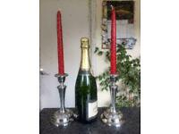 Silver Plated Candlesticks with candles.