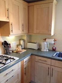 Light wood kitchen with hob and oven