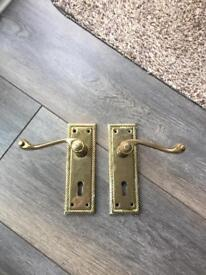 Brass door handles with lock hole