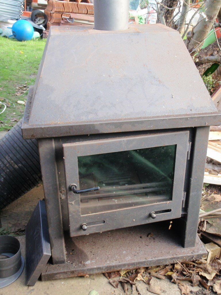 Woodburner. Unused,. 27inch. high or 42inch. with hood.