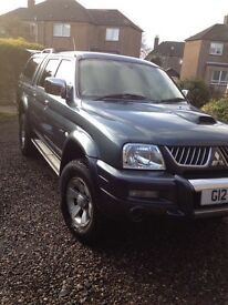 Mitsubishi L200 Warrior, with hard top and bedrug, tow bar and electrics.