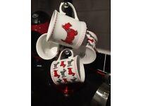 Scottie dog china drinking mugs.