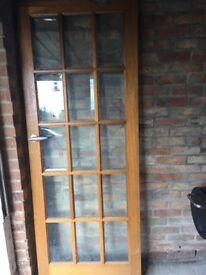 Wooden door with glass windows