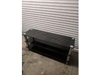 Used dark glass TV stand