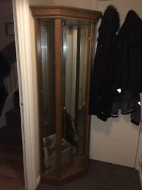 Good condition, teek in colour, 6 foot in height glass shelf corner unit