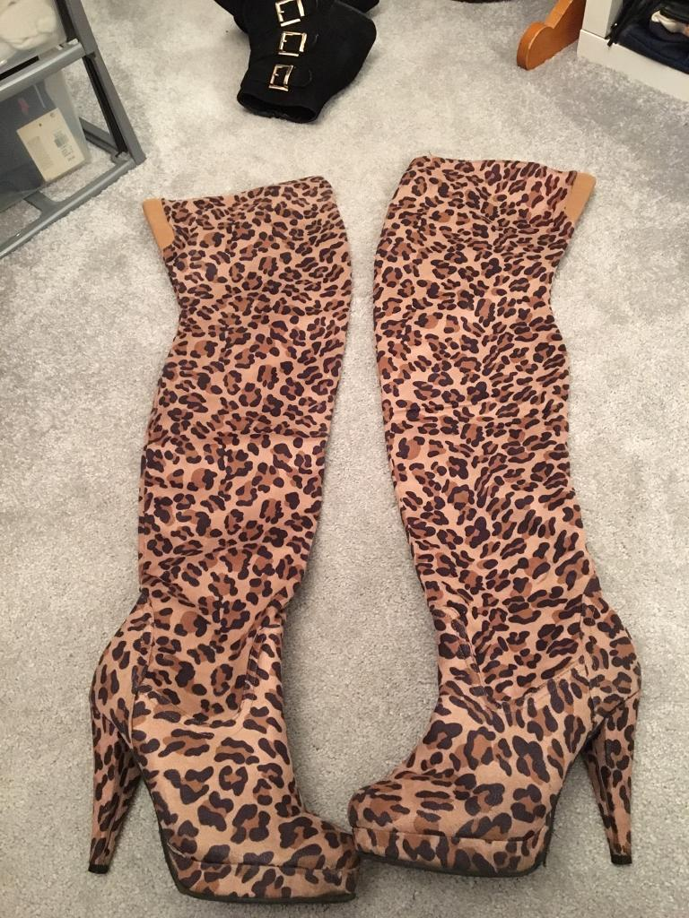 Leopard print over knee boots