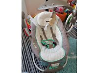 baby swing/bouner. excellent condition. seat vibrates palys music and several swing speeds