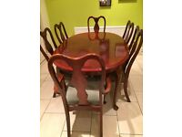 Dining table and 6 chairs, High sheen rose wood.