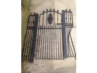 Wrought iron gate and posts