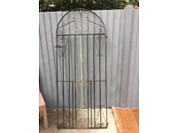 Arched wrought iron gate