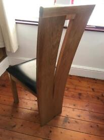 Solid oak very heavy dinning chairs