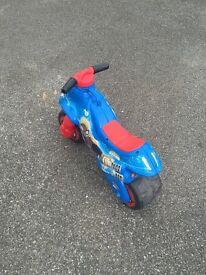Kids push motorcycle