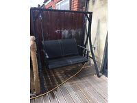 Black swinging bench