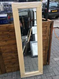 unstained wooden full length mirror