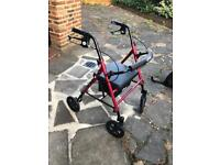 Four wheel rollator with adjustable seat