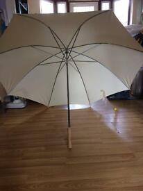 Cream colour 3 big umbrellas perfect for photo shoots