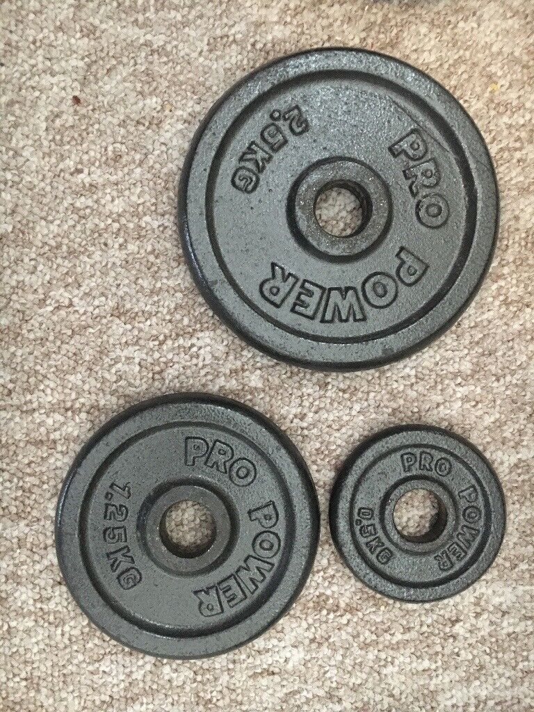 Pro power dumbbell weight set. Iron cast with plastic grips.