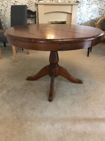 Beautiful varnished extending pine table.