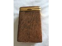 Antique snake skin & bronze cigarette case .