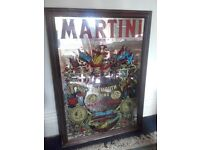 martini mirror picture. re 1970. surrounded by brown wood frame. used but in good condition