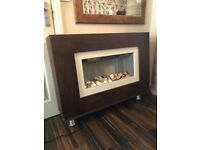 Electric pebble effect fire, wood surround