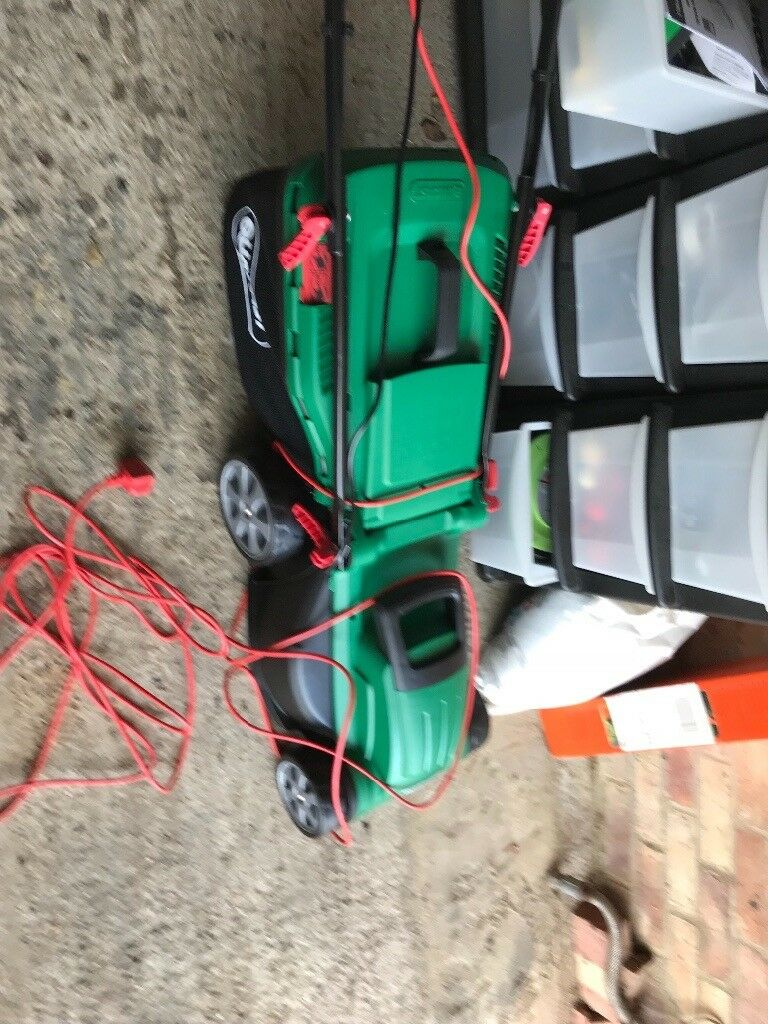 Qualcast 1400w rotary lawn mower brand new and black and decker 250w ...